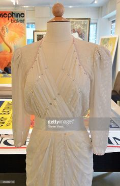 A Zandra Rhodes ivory silk chiffon gown embellished with simulated pearls and deep pink faceted glass worn by HRH Princess Diana to the Birthright benefit at the London Palladium, May 1987, to be auctioned by Julien's Auctions of Beverly Hills December 5-6, 2014 on display at Ross Art Gallery on November 12, 2014 in New York City.