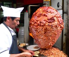 """Tacos Al Pastor also known as """"shepherd's tacos,"""" are a popular Mexico City Street food. Tacos al pastor are made from marinated pork which is soaked in fruit juices, chilli and spices and put on a skewer to grill."""