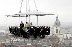 Dinner In The Sky is a Belgian based novelty restaurant which used a crane to hoist its diners, table, and waitstaff 150 feet into the air. Sky Restaurant, Dinner In The Sky, Womens Health Magazine, The Weather Channel, Weird Pictures, Take A Seat, Weird Facts, Places To See, Cool Photos