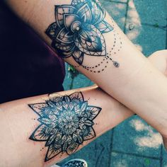 Mandala tattoos-- love the forearm placement.