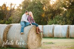 Cute Couple Pose | Couple Sitting on Hay Bale | Rustic Couples Photography