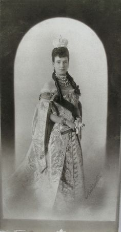 Marie Feodorovna wears The Small Imperial Crown. Her hair were pulled back in two braids laid on her shoulders as it was required by The Imperial Wedding and Coronation Minutes confirmed by Catherine II The Great. One reason of conflict between Marie and Nikolay II's wife was the fact that Marie refused to give Alix Russian Empress's Jewelry that should be worn by Empress though Nikolay II insisted on this. Later Marie gave Alix some of them but refused to give her the most valuable jewels.