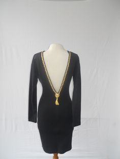 Look good coming and going in this plunging back dress.