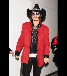 Johnny Depp rocks a western look while arriving at Narita International Airport Narita, Japan, on May 12, 2012