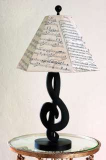 Black Treble Clef Table Lamp with Sheet Music. Here is to all my music lovers who want a musical theme room, this lamp would look cute by your bed side.