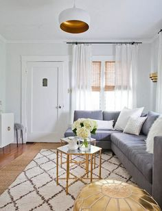 making the most of a small space with a sectional couch and a neutral Moroccan rug