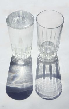 All i need to do to create this photo is to get couple of glasses of water and but the flash at the back of the glasses and photograph the front of them. I like the idea of this photograph because of the shading that the water in the glass makes and also the shape of the glasses determines the the type o shadow created as well