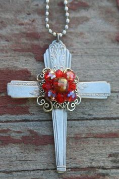 Silverware handles form the cross. Use an old brooch in the center.