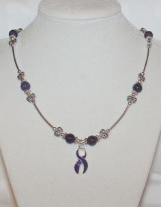 Purple awareness necklace with butterflies