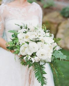 Floral designer Mindy Rice made a bouquet of white blooms, including peonies, camellias, ranunculus, nerines, and crispa tulips, for this bride's December wedding.