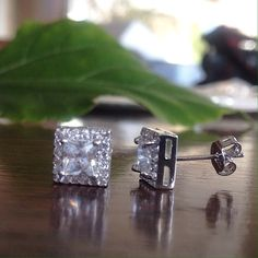 🎉SALE!🎉 NWT The Square Stud Earrings NWT Comes brand new with free black velvet pouch (black velvet earring box available upon request plus an additional $5 fee). Beautiful silver stud earrings with 0.75ct princess cut center stone and square halo setting.   Setting Type: Square Halo Stones: Clear Zircon Crystal Occasion: Bridal, anniversary, wedding, party, costume, or daily  Metals Type: 925 Sterling Silver  *This is a NWT Retail item. *NO Trades! Meredith's Boutique Jewelry Earrings