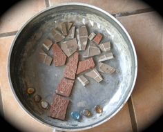 Mosaic stepping stones. See also Tip Nut's stepping stone page at http://tipnut.com/stepping-stones-paths/