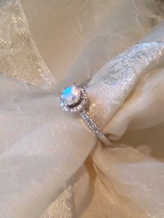 Solitaire Engagement Ring Rainbow Moonstone by NorthCoastCottage, $179.00 http://www.etsy.com/listing/128423558/solitaire-engagement-ring-rainbow?ref=pr_faveitems