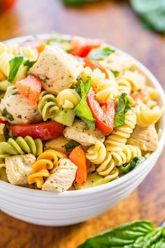 Italian Chicken Pasta Salad - Easy, ready in 20 minutes, and healthy! Bursting with fresh flavors from juicy tomatoes, cucumber, basil, parmesan, and tender chicken tossed in a tangy lemon vinaigrette!!