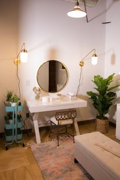 Matching gooseneck sconces give glamorous and good lighting in a vanity area!