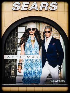 Attitude Jay Manuel fashion poster on the Sears storefront wall
