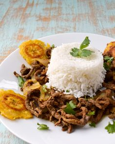 Puerto Rican Bistec Encebollado - steak and onion marinated in a garlicky vinegar sauce. Plus a bonus recipe for tostones (fried plantains)!