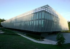 Architectural wire mesh from GKD encases the façade of the home of FIFA. The wire grate mesh façade lends the building a floating appearance. Fifa, Office Hub, Safety And Security, Canopy, Interior And Exterior, Facade, Skyscraper, Louvre, World