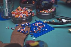 A bowl filled with beads means kids can create patterns on the beadboards with ease, all on the activity table.
