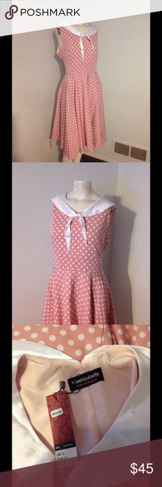 """Vintage 50s Sailor Style PolkaDot Full Skirt Dress Very nice vintage inspired dress. Polka dot with a full flared skirt. Sailor tie around the neck. Size 14 - brand new with tags. Fits true to size. Chest 41"""" Waist 36"""" 200"""" around the bottom BlackButterfly Dresses"""