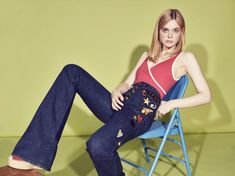 Elle Fanning poses in Solid & Striped swimsuit with embellished denim
