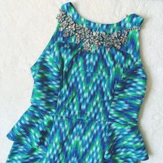HP! Milly   Peplum dress w/back zipper This stunning sleeveless dress features a peplum waist ruffle and back zipper. In excellent condition--no holes or stains! No trades or PayPal. Milly Dresses