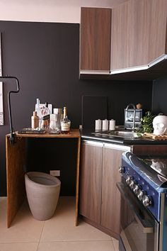 Misty and Pai retained the original materials and fixtures in the kitchen. They spruced up the standard-issue kitchen with a few decorative touches.