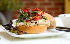 Philly Style Roast Pork Sandwich – The Real Deal!roast pork with provolone cheese, roasted red peppers and broccoli rabe