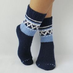Blue hand knit socks with ornament.  Winter is around the corner so we are preparing these awesome handmade rustic socks to warm your feet!   (any