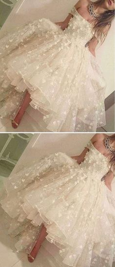 Lacy ruffles & a full-skirt of Tulle, pretty White Prom dress