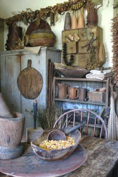 Primitive farmhouse.  Reminds me of Tasha Tudor.  Lots of natural materials and dried  plants