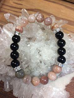 Sun Stone & Black Onyx beaded bracelet by BTUbythesea on Etsy https://www.etsy.com/ca/listing/234440219/sun-stone-black-onyx-beaded-bracelet #OnyxBracelets