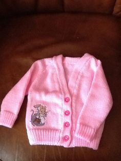 Hand knitted baby cardigan with Beartrix by Happilyevercrafts, £12.00