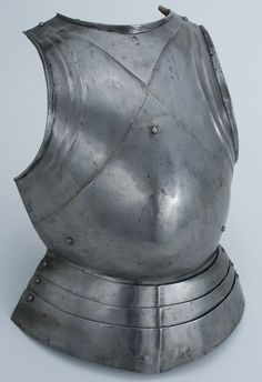"Infantry breastplate ""in the German style"" Origin Northern Italy (Milan), about 1480 Artist Master ""IA"" Materials Steel; modern leather Measure 14"" W x 21"" L x 7"" D Weight 6 lb. 4 oz."