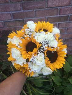 Wedding bouquet of Sunflowers, white spray roses, babies breath