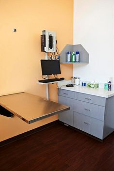 Accent wall. Minimal storage. A sink is not necessary in every exam room and saves significantly on construction costs. I do not like the exposed wiring.