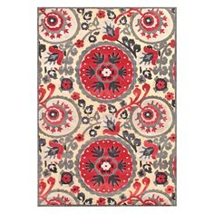 Loomed art silk rug with a multicolor suzani medallion motif.