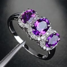 Amethyst engagement ring. What a beautiful ring.                                                                                                                                                      More