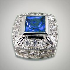 Sterling silver square slide with a princess cut arctic blue cubic zirconia center Metal:Sterling Silver Designer:Goldman-Kolber $ 140.00 Item #: MMX0CQ Call 870-863-8818 for personal consultation.