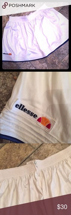 Sexy adorable vintage Italian tennis skirt! Oh my gosh, how cute is this? Waist 28 inches, open, length 14 inches. Perfect condition. By Ellesse. Made in Italy. Vintage Skirts Mini