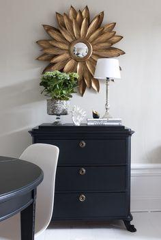 Starburst mirror + deep navy dresser