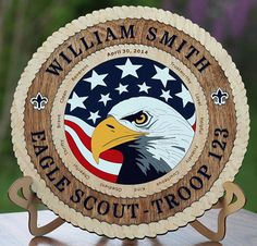 These are a work of art! What a wonderful gift to give to a Scout that has achieved the highest rank possible in Boy Scouts. The plaque is made from Birch and is 3/8 thick. All pieces are cut and painted. There are no stickers or decals. What you see is wood. The plaques are beautifully finished and have a minimum of 3 to 5 coats of lacquer to add a beautiful protective finish. Although you cant really tell from the photos, the plaques have a beautiful, clear, glass like finish on them…
