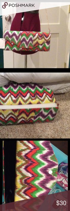 "LMoshion multi color purse with chain NWOT linen feel clutch with chain shoulder strap. Multi colors go with lots of outfits. 12""x5""X1 1/2"". Still has foam filler to maintain its shape. Black lining. lmoshion Bags Clutches & Wristlets"