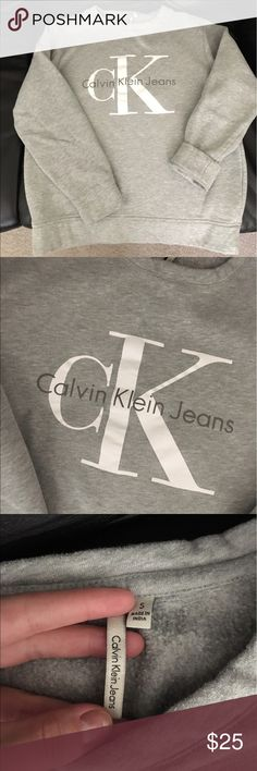 Women's Calvin Klein sweatshirt size small Awesome grey Calvin Klein sweatshirt great condition very comfy! Doing some closet spring cleaning! From a pet free smoke free home please ask if you have any questions. Calvin Klein Sweaters Crew & Scoop Necks