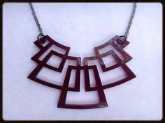 New Design: Space Warrior - transparent red laser cut acrylic jewelry. Gun metal chain. By  Laurel Stalla Design