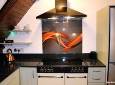 """A wonderful photograph of the 'Elegant Design' splashback taken by another happy customer. Mrs H said """"We are absolutely delighted with our splash-back and the service you provided. It's perfect or our new kitchen. Glass Splashbacks, New Kitchen, Color Splash, Clear Glass, Photograph, Elegant, Happy, Design, Photography"""