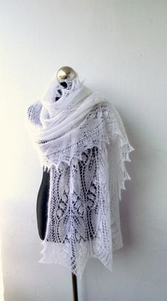 Lily of the Valley white  wedding shawl, hand knitted luxurious lace stole,white kidsilk  shawl. $135.00, via Etsy.