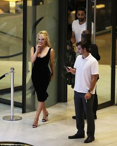 Date night: The rumoured new couple were pictured emerging from the upmarket Fairmont Hotel in Monaco earlier this month after a meal