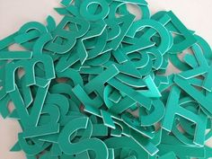 Jillibean Soup Beanboard Alphas Teal–they come in lots of awesome colors, and they STICK!!!! Really :) I'm loving them. Same font as the minis, lots of letters!