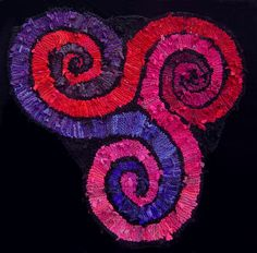 """Red, pink & purple triple #spiral hand knit #rug, approx. 68"""" on a side.  aka triskele. www.karentiede.com/rugs-sold"""